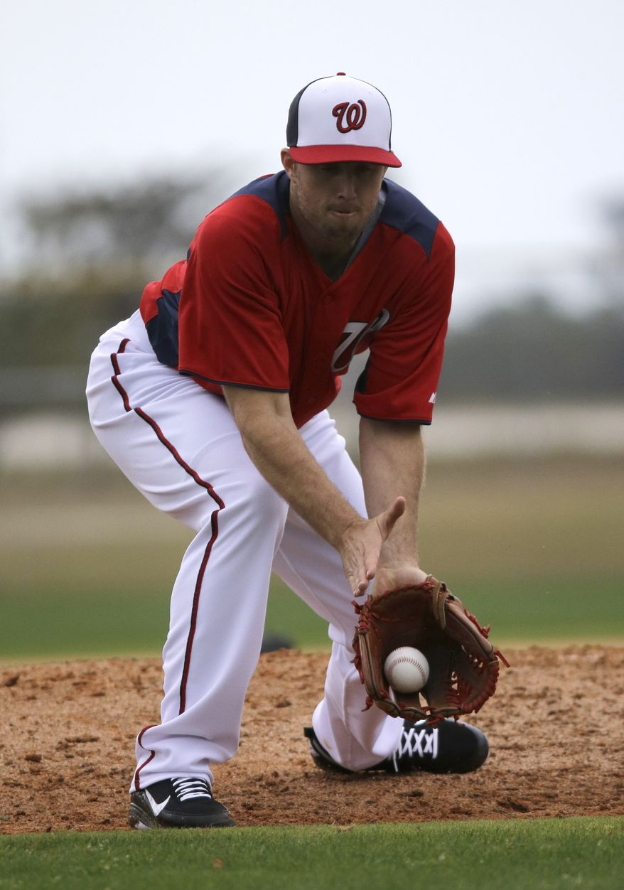 Washington Nationals pitcher Jeremy Accardo fields a ground ball during a spring training baseball workout Thursday, Feb. 14, 2013, in Viera, Fla. (AP Photo/David J. Phillip)