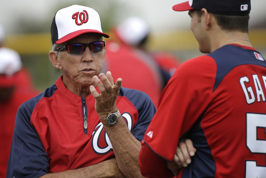Washington Nationals manager Davey Johnson, left, talks with pitcher Christian Garcia during a spring training baseball workout Thursday, Feb. 14, 2013, in Viera, Fla. (AP Photo/David J. Phillip)