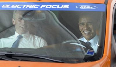 ** FILE ** President Obama (right) and Holland, Mich., Mayor Kurt Dykstra sit in an electric Ford Focus at the groundbreaking ceremony for Compact Power Inc., a subsidary of LG Chem Ltd., on Thursday, July 15, 2010, in Holland, Mich. (AP Photo/Susan Walsh)