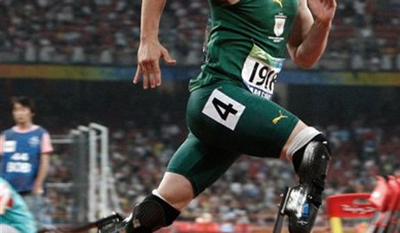 Oscar Pistorius of South Africa competes in the Men's 400m T44 final at the Beijing 2008 Paralympic Games in Beijing, China. Paralympic superstar Oscar Pistorius was charged Thursday, Feb. 14, 2013, with the murder of his girlfriend who was shot inside his home in South Africa, a stunning development in the life of a national hero known as the Blade Runner for his high-tech artificial legs.