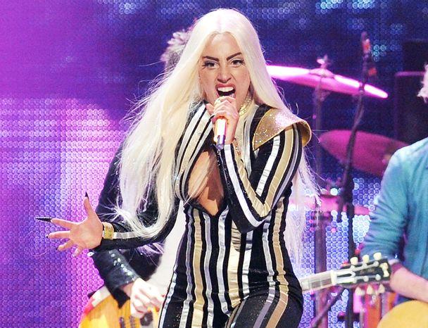 ** FILE ** Lady Gaga performs at the Prudential Center in Newark, N.J., on Saturday, Dec. 15, 2012. (Evan Agostini/Invision/AP)