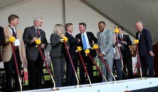 Gov. Bob McDonnell, center left, shakes hands with Bruce Allen, center right, general manager of the Washington Redskins NFL football team, alongside first lady of Virginia Maureen McDonnell and Richmond Mayor Dwight Jones during a groundbreaking ceremony for the future site of the Bon Secours Washington Redskins Training Center, Thursday, Feb. 14, 2013, in Richmond, Va. (AP Photo/Richmond Times-Dispatch, Daniel Sangjib Min)