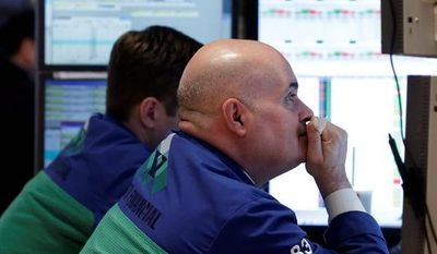 Specialist Anthony Confusione (right) works at his post on the floor of the New York Stock Exchange on Thursday. The stock market recently surged to five-year highs. Many small investors remain skittish, however. (Associated Press)