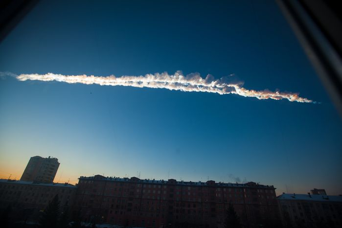 A meteorite contrail is seen over Chelyabinsk, Russia, on Friday, Feb. 15, 2013. A meteor streaked across the sky of above the Ural Mountains, causing sharp explosions and reportedly injuring hundreds of people, including many hurt by broken glass. (Associated Press)