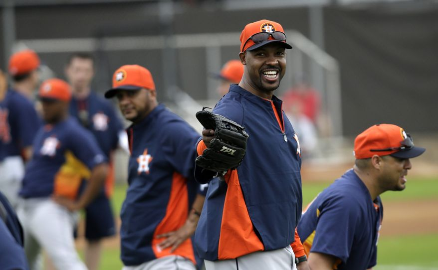 Houston Astros manager Bo Porter talks to his players as they stretch during a spring training baseball workout Wednesday, Feb. 13, 2013, in Kissimmee, Fla. (AP Photo/David J. Phillip)