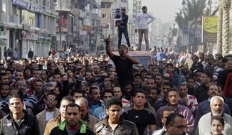 ** FILE ** Egyptians march in a funeral procession for three people who died in demonstrations marking the second anniversary of the Jan. 25, 2011, Egyptian revolution in Suez, Egypt, Saturday, Jan. 26, 2013. (AP Photo/Ahmed Abd El-Latef, Shorouk Newspaper)