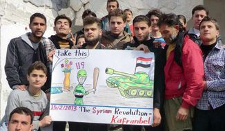 This citizen journalism image provided by Edlib News Network, ENN, which has been authenticated based on its contents and other AP reporting, shows anti-Syrian regime protesters holding a caricature placard during a demonstration, at Kafr Nabil town, in the Idlib province of northern Syria, on Feb. 15, 2013. (Associated Press/Edlib News Network ENN)