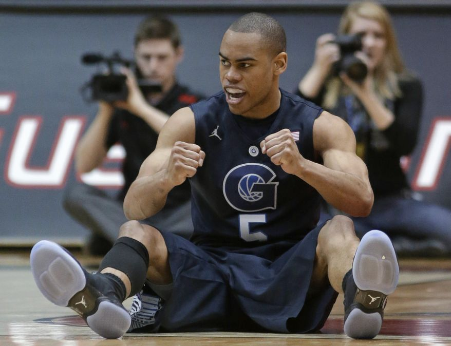 Georgetown guard Markel Starks clenches his fists after drawing a charging foul against Cincinnati in the second half of an NCAA college basketball game, Friday, Feb. 15, 2013, in Cincinnati. Starks led Georgetown to a 62-55 win with 17 points. (AP Photo/Al Behrman)