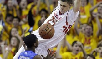 Maryland center Alex Len, top, of Ukraine, dunks on Duke forward Amile Jefferson in the first half of an NCAA college basketball game in College Park, Md., Saturday, Feb. 16, 2013. (AP Photo/Patrick Semansky)