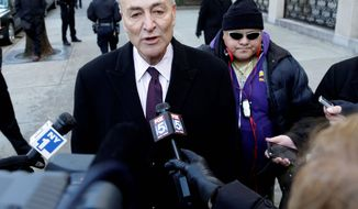 """""""I am not going to get into the details of our negotiating, publicly, but I can tell you we've both made progress and have a ways to go"""" before an agreement on background checks, Sen. Charles E. Schumer, New York Democrat, says. (Associated Press)"""