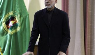 Afghan President Hamid Karzai addresses military officers in Kabul, Afghanistan, on Saturday, Feb. 16, 2013. (AP Photo/Ahmad Jamshid)