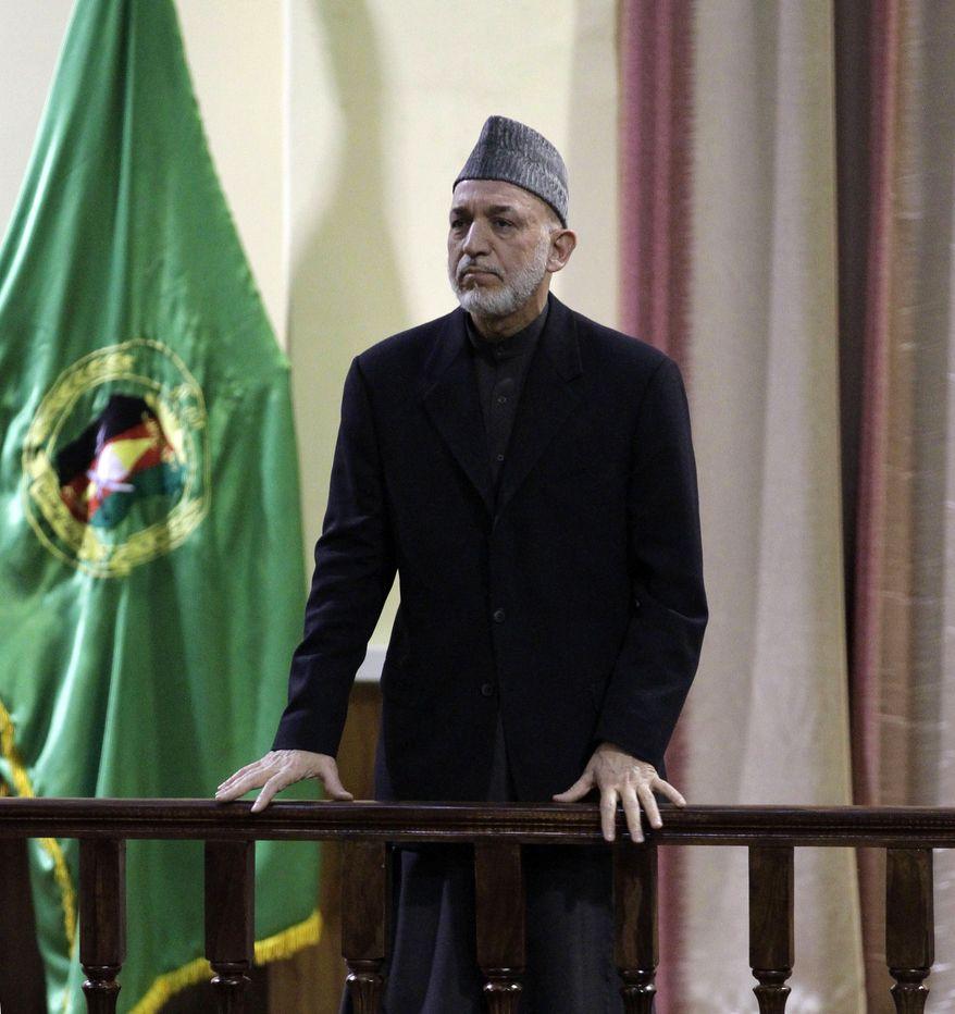 Afghan President Hamid Karzai addresses military officers in Kabul, Afghanistan, on Saturday, Feb. 16, 2013. (AP Photo/Ahmad Jamshid)