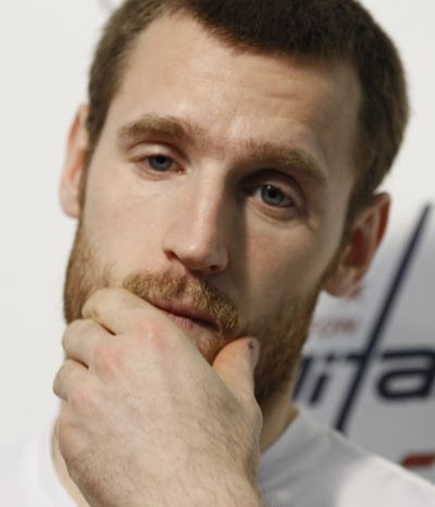**FILE** Washington Capitals' Brooks Laich rubs his face during a news conference at the Kettler Capitals Iceplex in Arlington, Va., Thursday, May 5, 2011. The Capitals were swept out of the playoffs by the Tampa Bay Lightning, losing Game 4 at Tampa on Wednesday night.(AP Photo/Luis M. Alvarez)