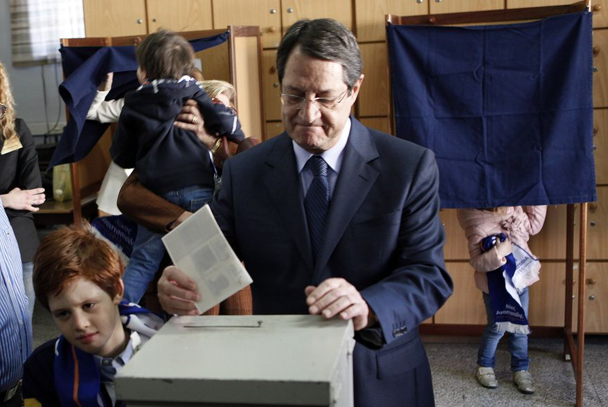Presidential candidate Nicos Anastasiades votes in Cypriot elections in the southern port city of Limassol, Cyprus, on Sunday, Feb. 17, 2013. Cypriots are voting for a new leader amid a financial crisis in which the country needs a rescue package from international creditors to stave off bankruptcy. (AP Photo/Petros Karadjias)