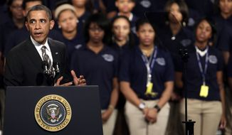 President Obama speaks about strengthening the economy for the middle class and the nation's struggle with gun violence at an appearance at Hyde Park Academy on Friday, Feb. 15, 2013, in Chicago. (AP Photo/M. Spencer Green)