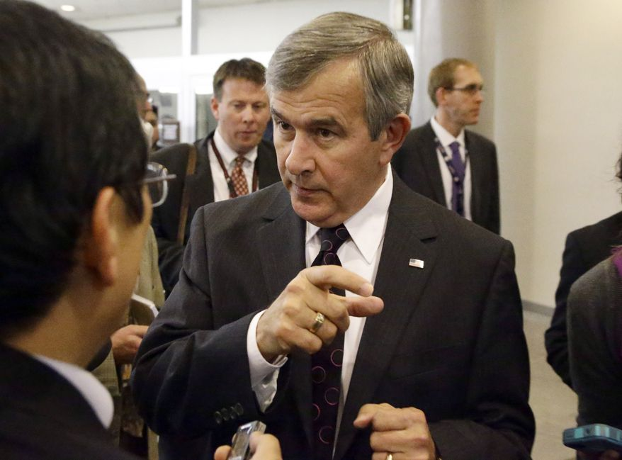**FILE** Sen. Mike Johanns, Nebraska Republican, speaks with reporters on Capitol Hill in Washington on Nov. 13, 2012. (Associated Press)
