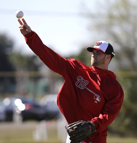 Washington Nationals outfielder Bryce Harper throws during a spring training baseball workout Sunday, Feb. 17, 2013, in Viera, Fla. (AP Photo/David J. Phillip)