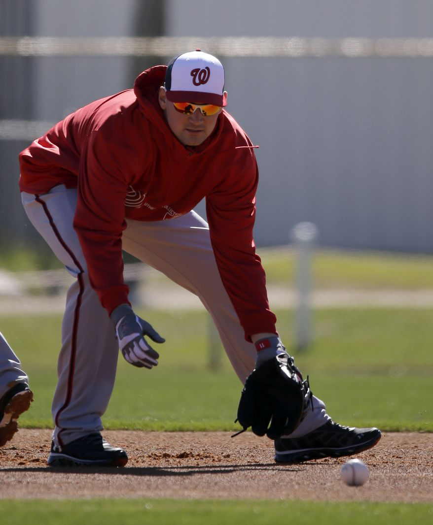 Washington Nationals third baseman Ryan Zimmerman fields a ground ball during a spring training baseball workout Sunday, Feb. 17, 2013, in Viera, Fla. (AP Photo/David J. Phillip)