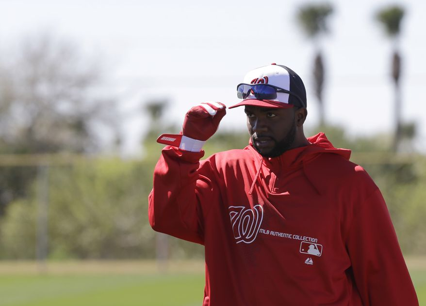 Washington Nationals outfielder Denard Span adjusts his cap during a spring training baseball workout Sunday, Feb. 17, 2013, in Viera, Fla. (AP Photo/David J. Phillip)