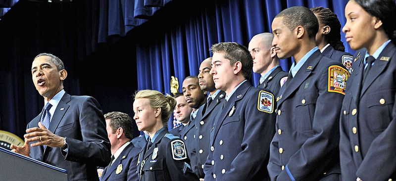** FILE ** President Obama warned about the dire consequences of failing to avert budget cuts Tuesday in front of 17 uniformed firefighters and law enforcement officers, who he said could lose their jobs. (Associated Press)