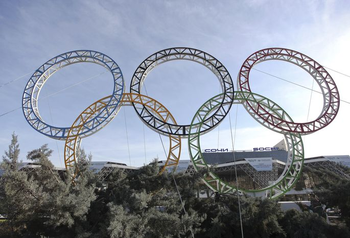 ** FILE ** The Olympic rings for the 2014 Winter Games are installed in the Black Sea resort of Sochi, Russia, on Tuesday, Sept. 25, 2012. (AP Photo/Ignat Kozlov))