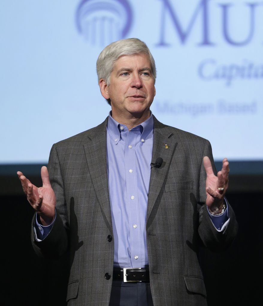 **FILE** Michigan Gov. Rick Snyder addresses Detroit Regional Chamber members in Detroit on Feb. 11, 2013. (Associated Press)