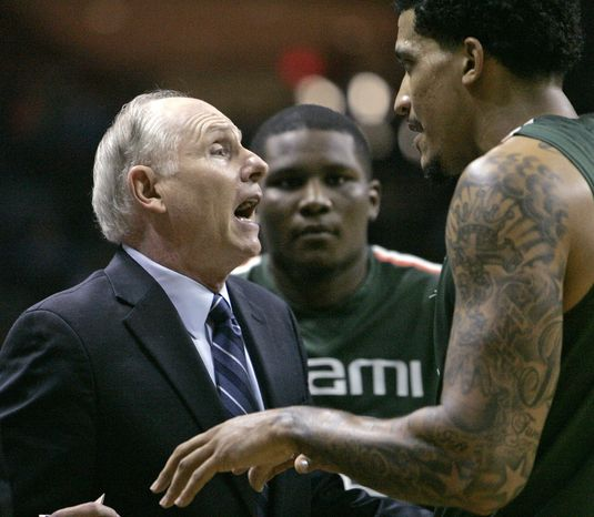 Miami coach Jim Larranaga talks with his players during a timeout in the second half of an NCAA college basketball game with Florida State on Wednesday, Feb. 13, 2013, in Tallahassee, Fla. Miami held off Florida State to win 74-68. (AP Photo/Steve Cannon)