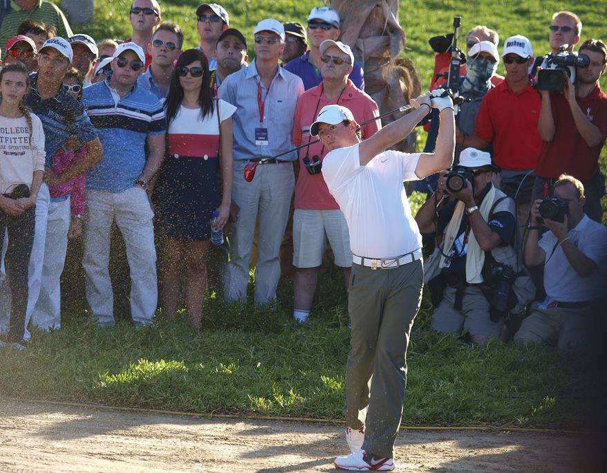 Rory McIlroy from Northern Ireland plays a ball on the 18th hole during the second round of Abu Dhabi Golf Championship in Abu Dhabi, United Arab Emirates, Friday, Jan. 18, 2013. (AP Photo/Manuel Salazar)