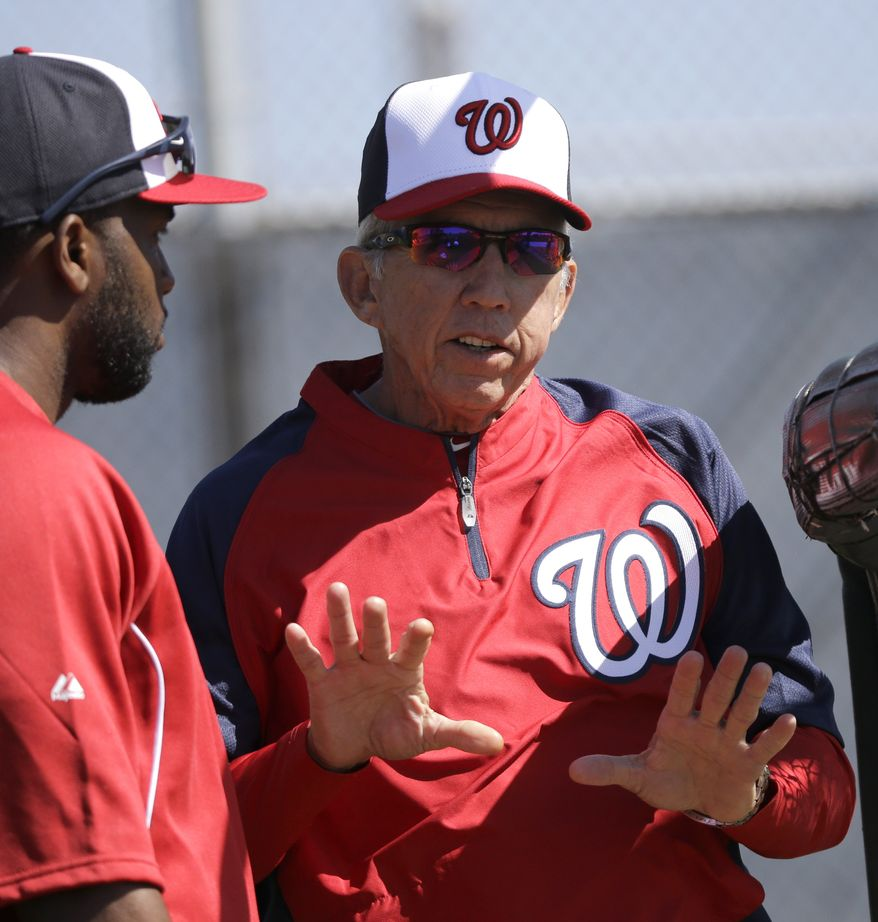 Washington Nationals manager Davey Johnson, right, talks with outfielder Denard Span, left, during a spring training baseball workout Tuesday, Feb. 19, 2013, in Viera, Fla. (AP Photo/David J. Phillip)