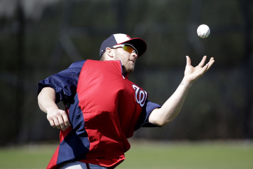 Washington Nationals outfielder Corey Brown catches a ball as part of a drill during a spring training baseball workout Tuesday, Feb. 19, 2013, in Viera, Fla. (AP Photo/David J. Phillip)