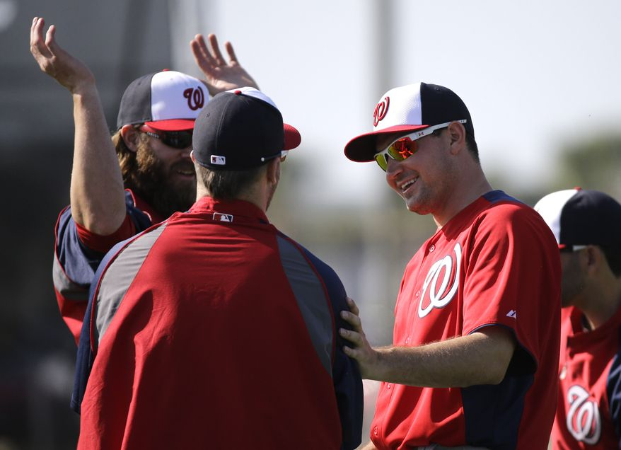Washington Nationals third baseman Ryan Zimmerman, right, talks with outfielder Bryce Harper during a spring training baseball workout Tuesday, Feb. 19, 2013, in Viera, Fla. (AP Photo/David J. Phillip)