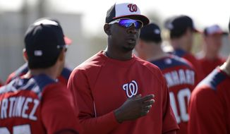 Washington Nationals pitcher Rafael Soriano waits with teammates for the start of a spring training baseball workout Tuesday, Feb. 19, 2013, in Viera, Fla. (AP Photo/David J. Phillip)