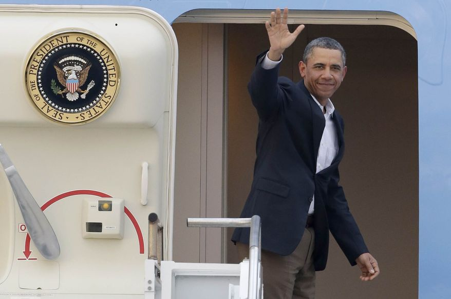 ** FILE ** President Obama waves in the doorway of Air Force One as he departs from Palm Beach International Airport in West Palm Beach, Fla., on Feb. 18, 2013. (Associated Press)