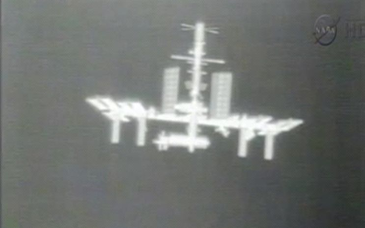 ** FILE ** The International Space Station is photographed by a thermal imaging camera aboard the SpaceX Dragon commercial cargo craft as it approaches the station on Thursday, May 24, 2012. (AP Photo/NASA)