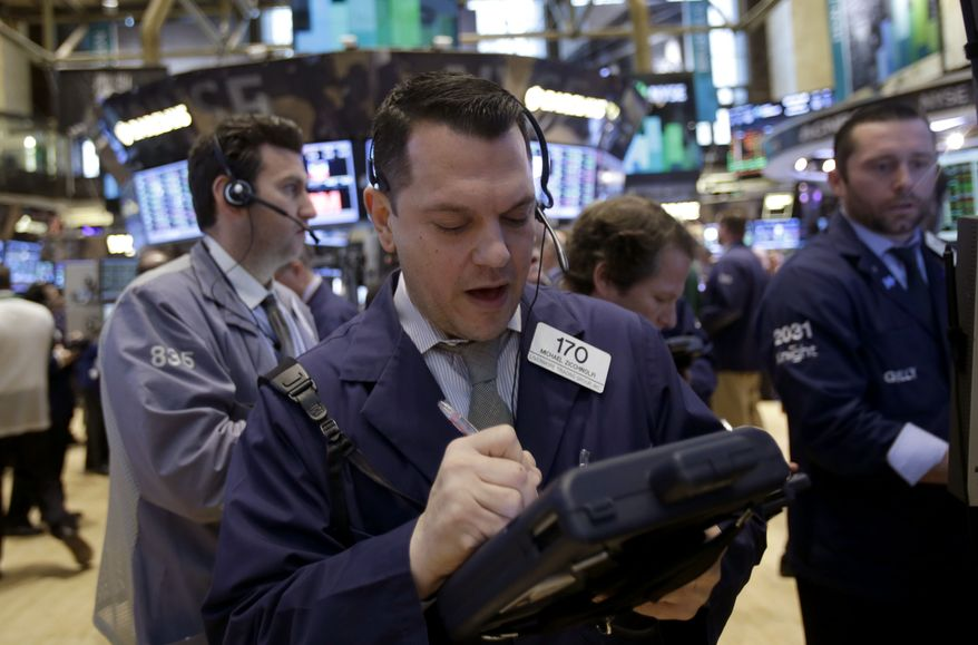 Traders work on the floor at the New York Stock Exchange in New York on Tuesday, Feb. 19, 2013. Talk of more mergers and acquisitions is sending stock prices higher in early trading, setting the market up to continue a seven-week rally. (AP Photo/Seth Wenig)