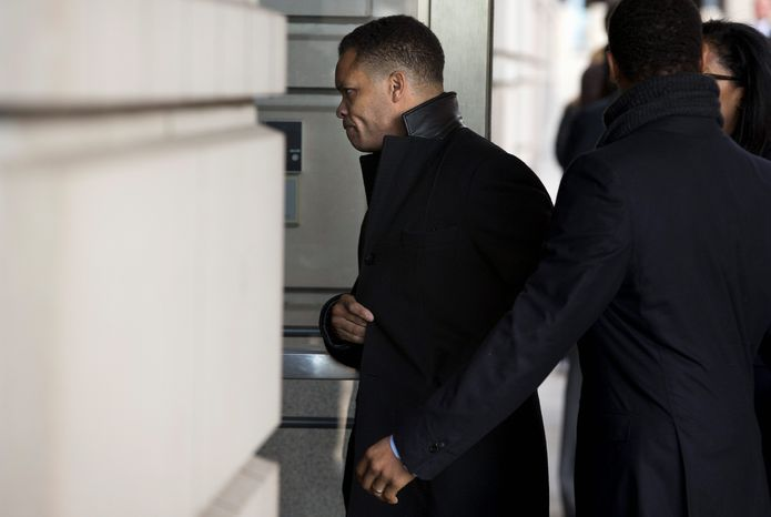 Former Rep. Jesse L. Jackson Jr. arrives at the E. Barrett Prettyman Federal Courthouse in Washington on Wednesday. He pleaded guilty to misusing more than $750,000 in campaign funds and is scheduled to be sentenced on June 28. (ASSOCIATED PRESS)