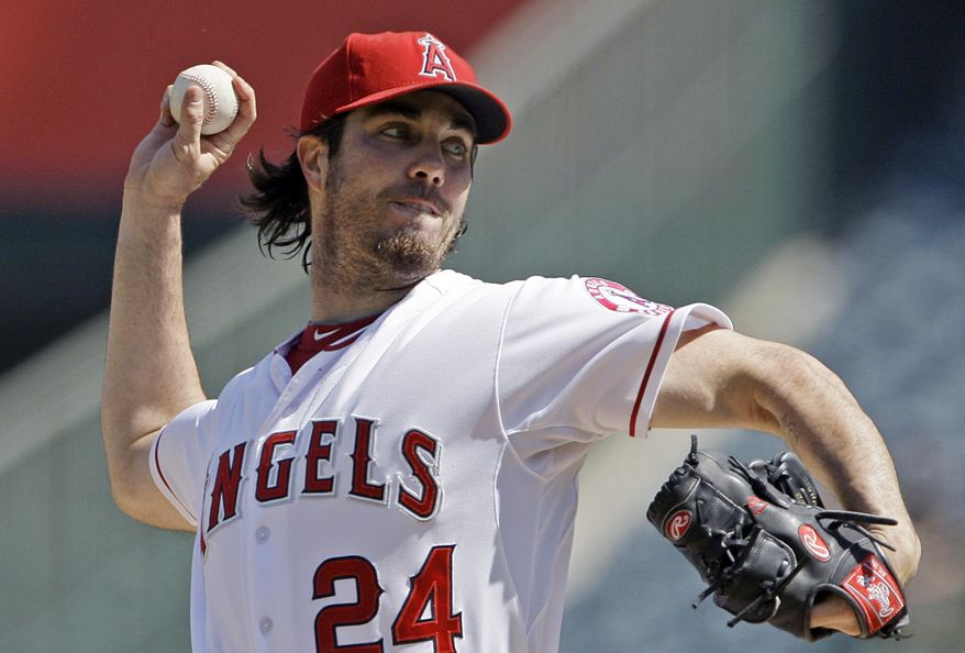 **FILE** In this Sept. 27, 2012, file photo, Los Angeles Angels starter Dan Haren pitches to the Seattle Mariners in the second inning of a baseball game in Anaheim, Calif. (AP Photo/Reed Saxon, File)