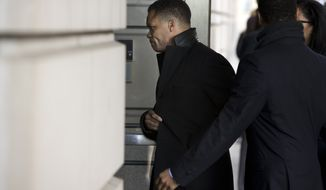 Former Rep. Jesse L. Jackson Jr., Illinois Democrat, arrives at the E. Barrett Prettyman Federal Courthouse in Washington on Wednesday, Feb. 20, 2013. Mr. Jackson was to appear in federal court to answer criminal charges that he engaged in an alleged scheme to spend $750,000 in campaign funds on personal items. (AP Photo/Evan Vucci)