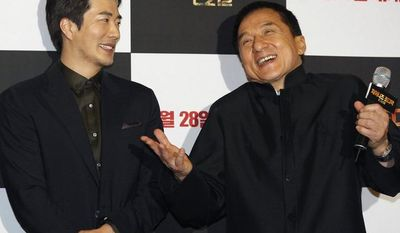 """Hong Kong actor-director Jackie Chan (right) and South Korean actor Kwon Sang-woo promote their latest movie, """"CZ12,"""" or """"Chinese Zodiac,"""" in Seoul on Monday, Feb. 18, 2013. (AP Photo/Ahn Young-joon)"""