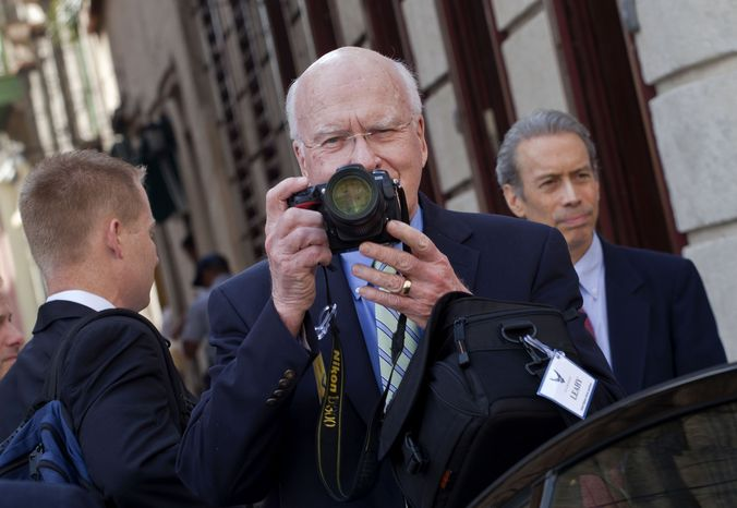 Sen. Patrick J. Leahy (center), Vermont Democrat, takes pictures after a meeting with Cuban Foreign Minister Bruno Rodriguez in Havana on Tuesday, Feb. 19, 2013. (AP Photo/Ramon Espinosa)