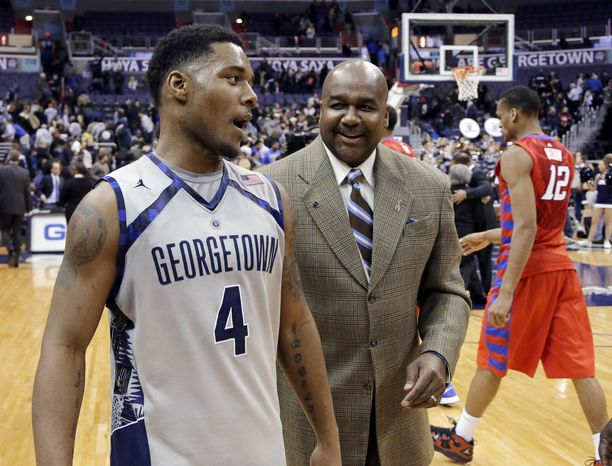Georgetown guard D'Vauntes Smith-Rivera (4) walks off the court with coach George Thompson III after an NCAA college basketball game against DePaul, Wednesday, Feb. 20, 2013, in Washington. Smith-Rivera had 33 points, as Georgetown won 90-66. (AP Photo/Alex Brandon)