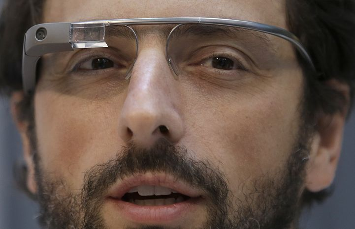 ** FILE ** Google co-founder Sergey Brin wears Google Glass glasses at an announcement for the Breakthrough Prize in Life Sciences at Genentech Hall on the University of California at San Francisco's Mission Bay campus in San Francisco on Wednesday, Feb. 20, 2013. (Associated Press)