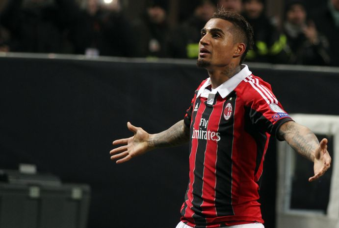 AC Milan's Kevin-Prince Boateng, left, celebrates after scoring during the Champions League round of 16, first leg soccer match between AC Milan and Barcelona, at the San Siro stadium in Milan, Italy, Wednesday, Feb. 20, 2013. (AP Photo/Felice Calabro')