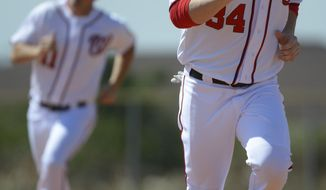 Washington Nationals' Bryce Harper (34) and Ryan Zimmerman (11) run the bases during spring training baseball in Viera, Fla., Wednesday, Feb. 20, 2013.(AP Photo/Phelan M. Ebenhack)