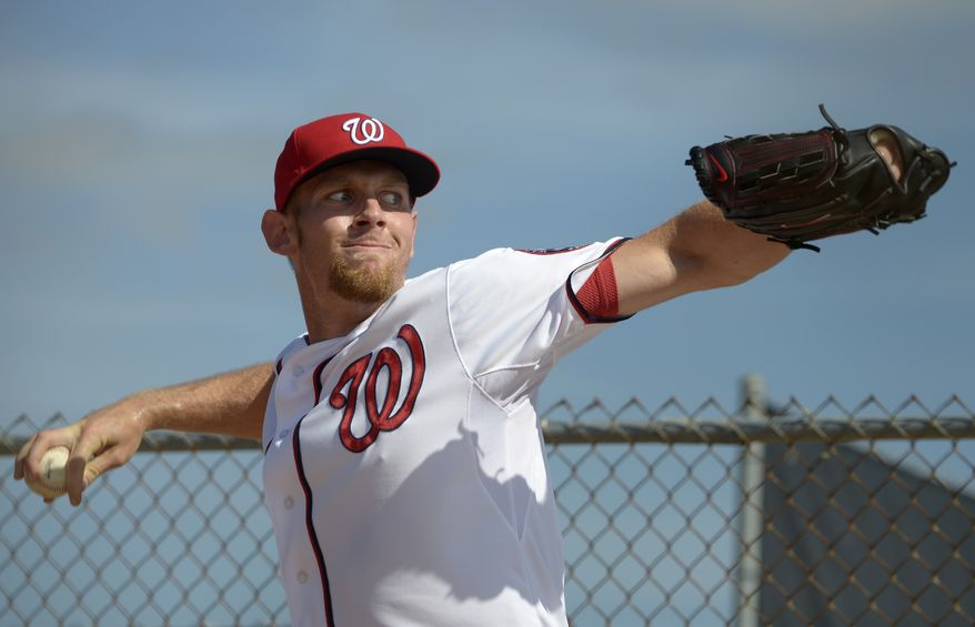 Washington Nationals pitcher Stephen Strasburg warms up in the bullpen during spring training baseball in Viera, Fla., Wednesday, Feb. 20, 2013.(AP Photo/Phelan M. Ebenhack)