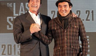 "Actor Arnold Schwarzenegger (left) poses with South Korean director Kim Jee-woon before a press conference to promote their latest film, ""The Last Stand,"" in Seoul on Wednesday, Feb. 20, 2013. (AP Photo Ahn Young-joon)"