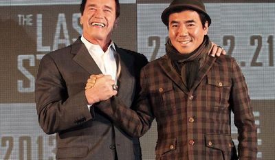 """Actor Arnold Schwarzenegger (left) poses with South Korean director Kim Jee-woon before a press conference to promote their latest film, """"The Last Stand,"""" in Seoul on Wednesday, Feb. 20, 2013. (AP Photo Ahn Young-joon)"""