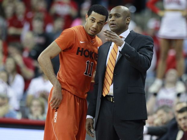 Virginia Tech's Erick Green (11) talks with coach James Johnson in the second half of an NCAA college basketball game against North Carolina State, Saturday, Feb. 16, 2013, in Raleigh, N.C. (AP Photo/The News & Observer, Ethan Hyman)