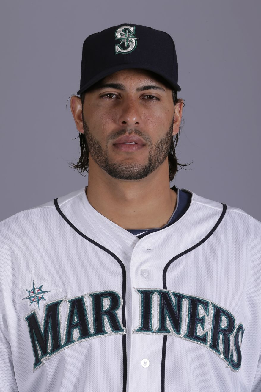 This is a 2013 photo of Michael Morse of the Seattle Mariners baseball team. This image reflects the Seattle Mariners active roster as of Feb. 19, 2013 when this image was taken in Peoria, Ariz. (AP Photo/Charlie Riedel)