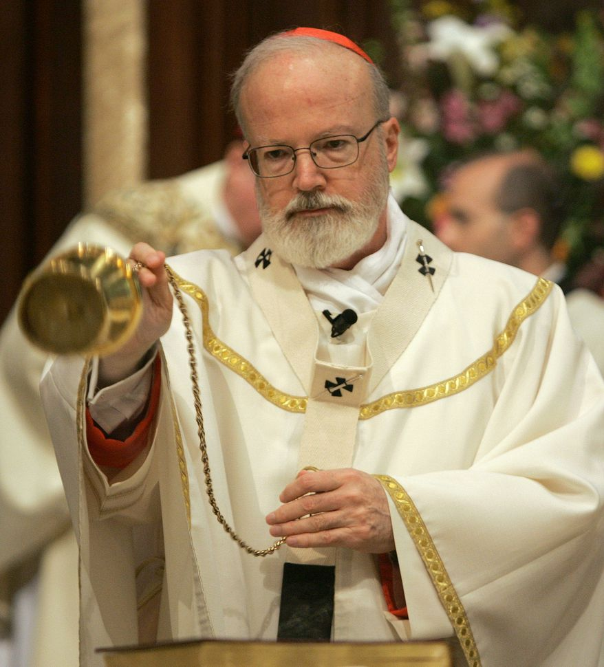 **FILE** Cardinal Sean O'Malley, archbishop of the Roman Catholic Archdiocese of Boston, sprinkles incense around the altar at Cathedral of St. Mary of the Assumption in Fall River, Mass., on April 18, 2006, as he begins to celebrate Mass. (Associated Press)